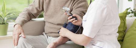 blood pressure gauge: Close-up of nurse holding blood pressure gauge