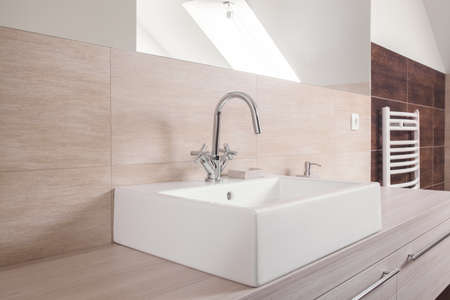 to sink: Square ceramic sink and shiny chrome faucet
