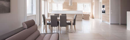 commodious: Panorama of dining space and kitchen in commodious house
