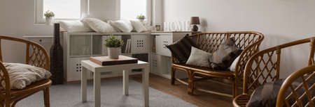 wood furniture: Panorama of neat furnished recreation place in white interior Stock Photo