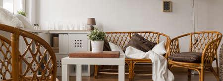 muebles de madera: Panoramic view of wicker sofa set in new lounge Foto de archivo