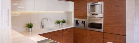 Panorama of stylish kitchen with decorative wood imitation tiles