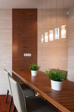 dining area: Photo of contemporary dining room with decorative lighting