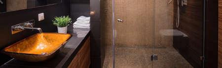 black bathroom: Panorama of bathroom with new design black and yellow washabasin Stock Photo