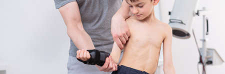 physiotherapists: Close-up of little boy in physiotherapists office - panorama