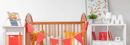 nursery: Wooden crib in beautiful baby nursery - panorama