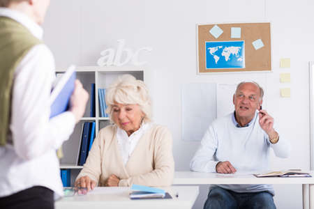 retirement community: Mature male student is discussing with professor Stock Photo