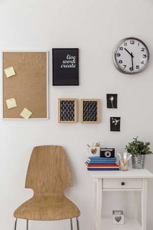 Bulletin board and wooden chair in designed room