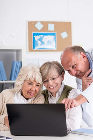 active adult community: Mature students are using modern technology at the university Stock Photo