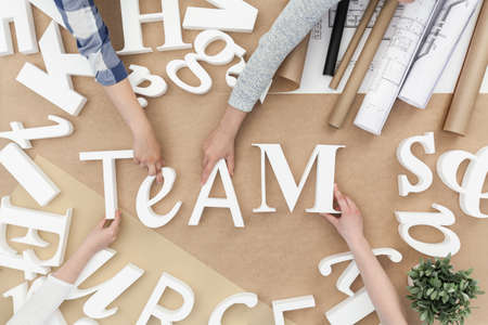 businesspeople: Team and teamwork - white letters on brown background