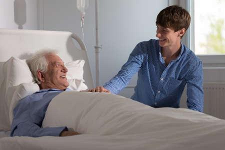 Picture of grandson visiting grandpa in hospital 版權商用圖片