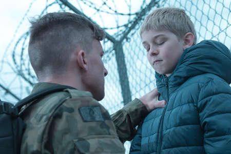 upset: Upset son and military dad saying goodbye Stock Photo