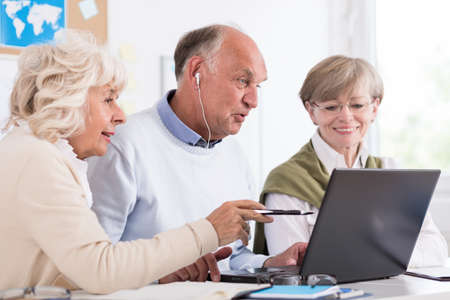 third age: Mature people are learning how to use a computer Stock Photo