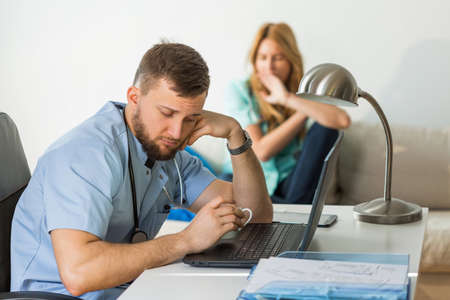 physician: Image of bored doctors in the office Stock Photo