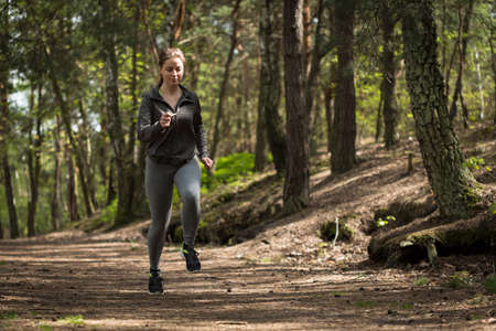 bosom: Girl running on wide path in the forest