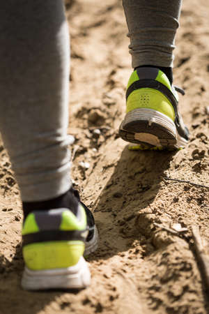 girl sport: Close-up of womans feet in yellow running shoes Stock Photo