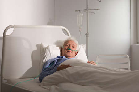 Seriously ill senior man staying in hospice Stock fotó