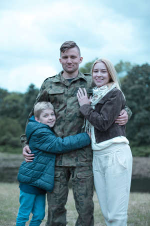 coming home: Soldier in military uniform and happy family