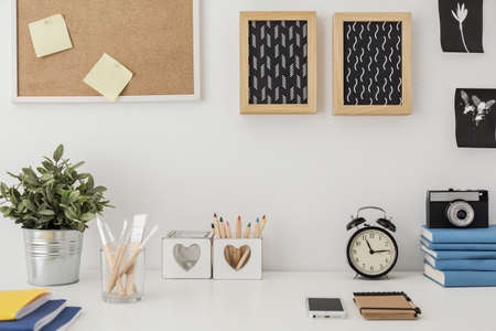 Close-up of stylish desk with designed equipment Archivio Fotografico