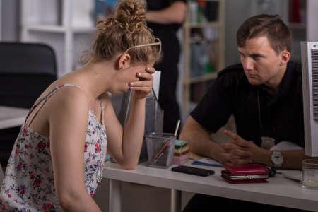 Image of despair crime victim on police station Standard-Bild