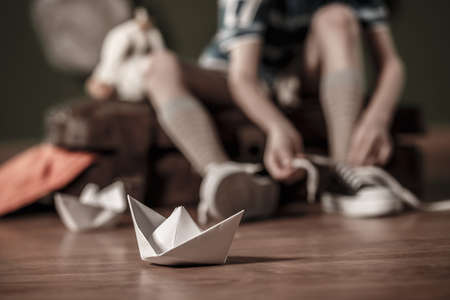 daydreamer: Close-up of paper ship on the floor