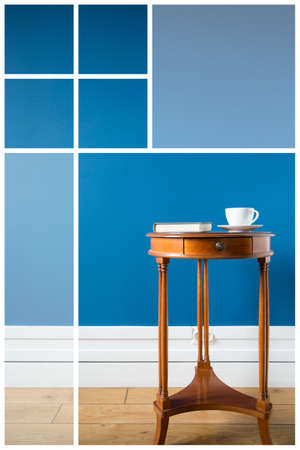 little table: Little table with cup of coffe and book Stock Photo