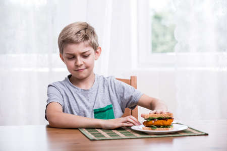 young: Image of fussy kid with chicken sandwich