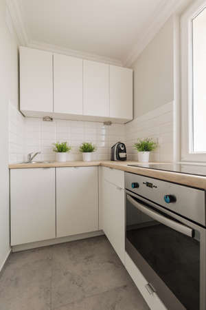 contemporary kitchen: Image of practical cupboards and solid oven in contemporary kitchen Stock Photo