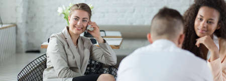 panoramic business: Young woman is talking on the phone during meeting Stock Photo