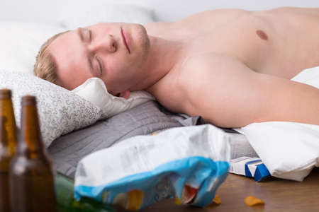Young man is unconscious from drinking too much Stock Photo