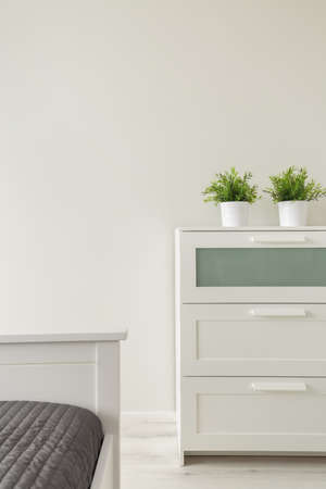 cosy: Close up of simple white wooden cabinet in cosy bedroom