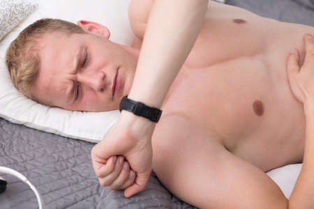 get tired: Man woke up and realized that he overslept Stock Photo