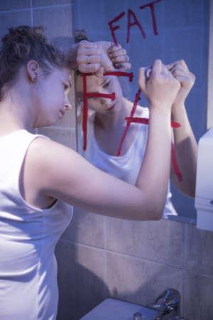 slim: Image of slim beautiful woman hating her body Stock Photo