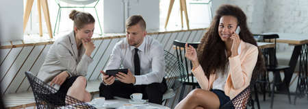 panoramic business: Young woman is phoning during business meeting Stock Photo