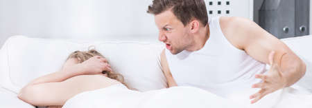 young wife: Young man is screaming at his wife Stock Photo
