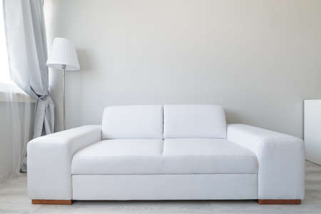 couches: Close up of white comfortable leather double sofa