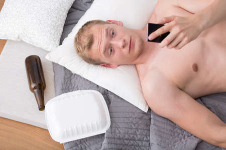 passed out: Man is looking surprised at photos from party