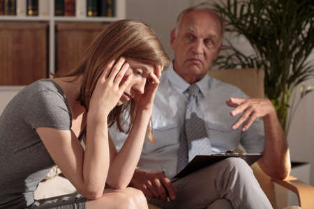 diagnosing: Photo of doctor diagnosing woman with mental disorder
