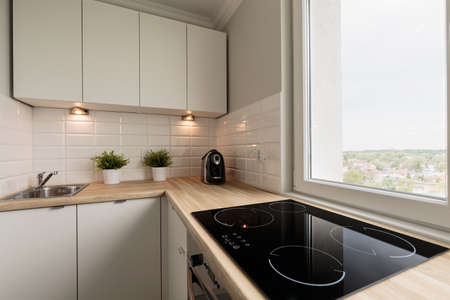 Image of functional light kitchen in new flat Foto de archivo