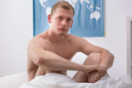 get tired: Man is feeling exhausted after partying all night Stock Photo