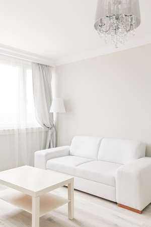 simply: Picture of small table and sofa in simply furnished lounge