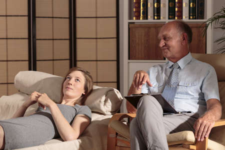 psychoanalysis: Image of male psychologist and his female patient during therapy