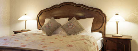 inside house: Hotel room bedroom with antique furniture Stock Photo
