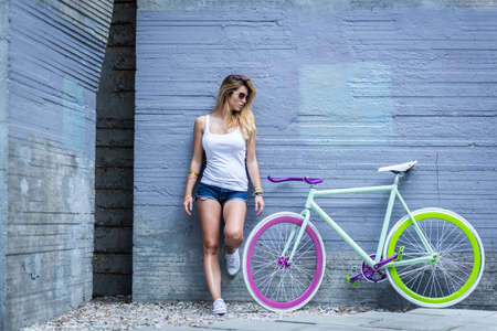 trendy: Photo of sporty girl and her trendy colorful bike