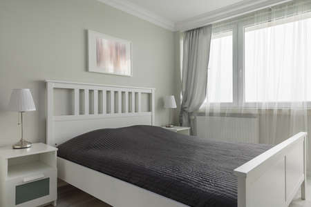 king size: Photo of king size white wooden bed with black bedding