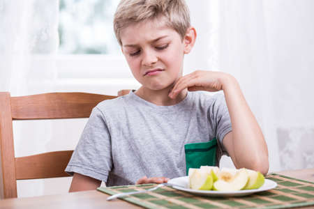 eater: Blonde boy refusing to eat healthy apple