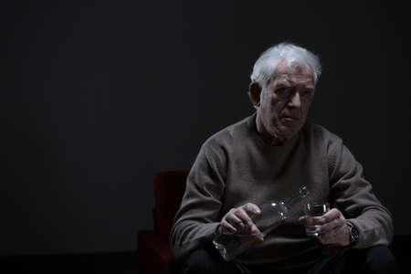 abuser: Portrait of senior man addicted to alcohol Stock Photo