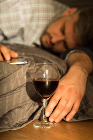 abuser: Drunk adult man sleeping on the bed
