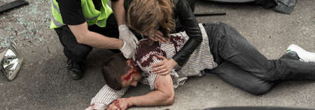 the unconscious: Unconscious bleeding man after dangerous car crash Stock Photo