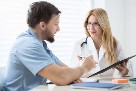patient's history: Two experienced physicians checking the patients history